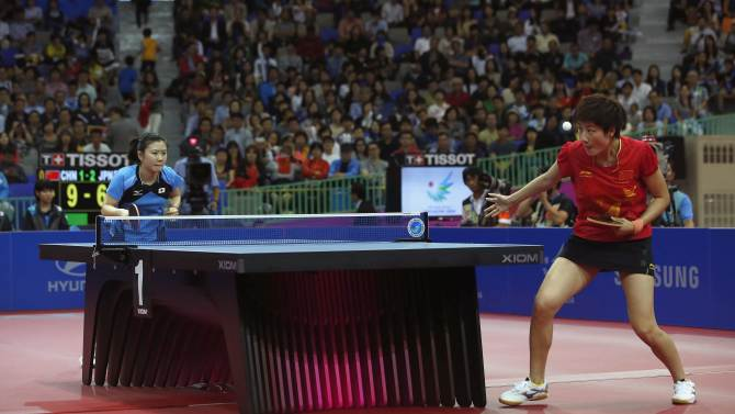 China's Ding Ning serves against Japan's Ai Fukuhara during their women's team gold medal table tennis match at Suwon Gymnasium during the 2014 Asian Games in Incheon