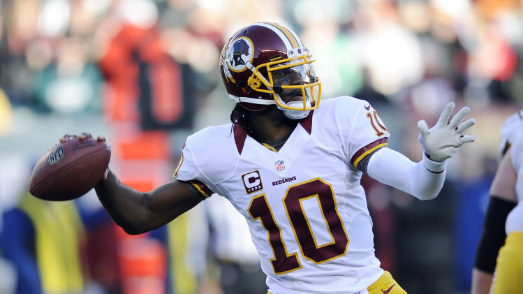 FILE - In this Dec. 23, 2012, file photo, Washington Redskins' Robert Griffin III throws a pass during the second half of an NFL football game against the Philadelphia Eagles in Philadelphia. Griffin was selected to the Pro Bowl on Wednesday, Dec. 26, 2012. (AP Photo/Michael Perez, File)