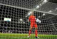 Britain's goalkeeper Jack Butland celebrates winning the London 2012 Olympic Games men's football match between Great Britain and Uruguay at the Millennium Stadium in Cardiff, Wales