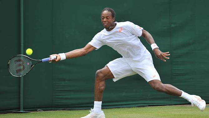 France's Gael Monfils returns against Czech Republic's Jiri Vesely during their men's singles second round match on day four of the 2014 Wimbledon Championships in southwest London, on June 26, 2014