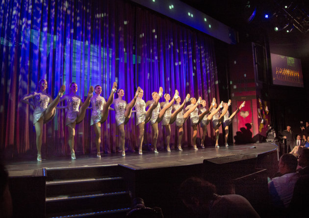 FILE - This May 8, 2013 file photo shows The Rockettes, best-known for dancing at the Radio City Christmas Spectacular, doing their signature kick line during christening ceremonies aboard the Norwegi