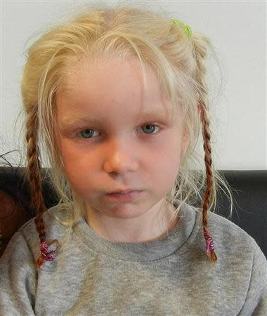 A four-year-old girl, found living with a Roma couple in central Greece, is seen in a handout photo distributed by the Greek police