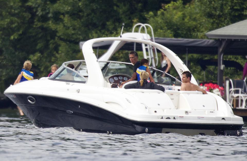 Republican presidential candidate, former Massachusetts Gov. Mitt Romney, takes his family for a boat ride on Lake Winnipesaukee on Saturday, July 14, 2012, in Wolfeboro, N.H.  (AP Photo/Evan Vucci)