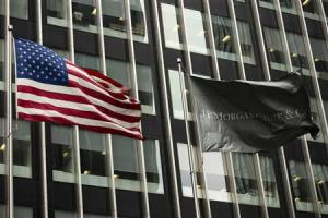 A U.S. and JPMorgan flag fly in front of the headquarters of JPMorgan Chase & Co bank in New York