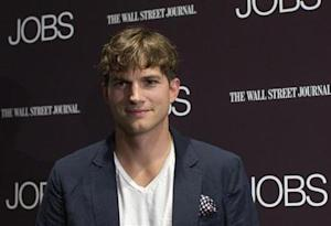 Ashton Kutcher poses on the red carpet before the premiere of the movie 'Jobs' in New York