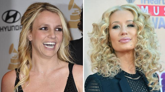 This combination of photos shows singer Britney Spears (L) and rapper Iggy Azalea, who teamed up for a song officially released on May 4, 2015