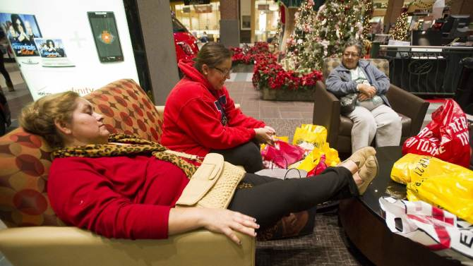 Doris Leyva (from left), Midory Leyva and Lilia Castro rest, surrounded by shopping bags, in a seating area at Wolfchase Galleria on Black Friday in Memphis, Tenn. Friday Nov. 23, 2112.. They had driven from Oxford, Miss. on Thursday night to be at the mall in time for early-opening sales. For the first time many retailers opened as early as 8 p.m. on Thursday sparking some criticism for shortening their employees' Thanksgiving holiday. (AP Photo, Brandon Dill, Commercial Appeal)