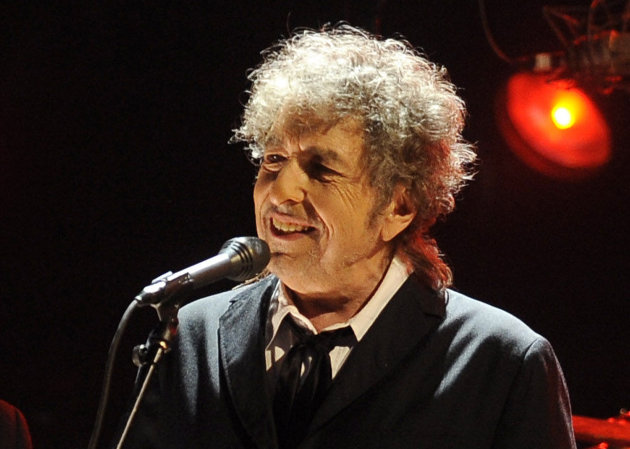 FILE - In this Jan. 12, 2012 file photo, Bob Dylan performs in Los Angeles. Fifty years into his career as a recording artist and a week away from release of an extraordinary new CD, Dylan spent his Tuesday evening where he seems to feel most comfortable  on a stage. (AP Photo/Chris Pizzello, File)
