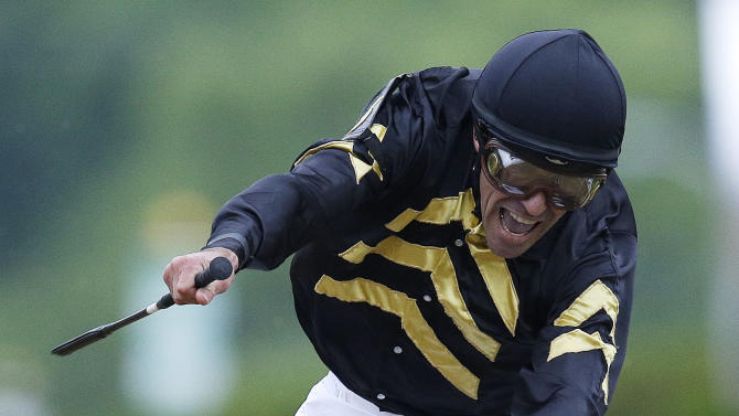 Jockey Gary Stevens celebrates aboard Oxbow after winning the 138th Preakness Stakes horse race at Pimlico Race Course, Saturday, May 18, 2013, in Baltimore.(AP Photo/Patrick Semansky)