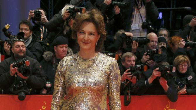Actress Gedeck arrives on the red carpet for screening at opening gala of the 66th Berlinale International Film Festival in Berlin