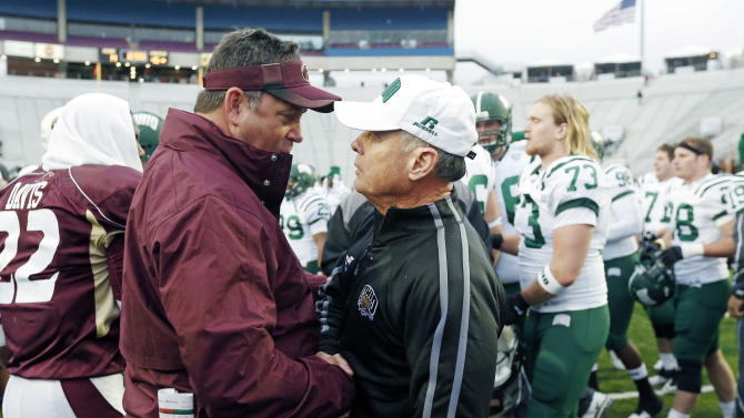 Louisiana-Monroe coach Todd Berry, left, congratulates Ohio coach Frank Solich after their 45-14 win in the Independence Bowl NCAA college football game in Shreveport, La., Friday, Dec. 28, 2012. (AP Photo/Rogelio V. Solis)