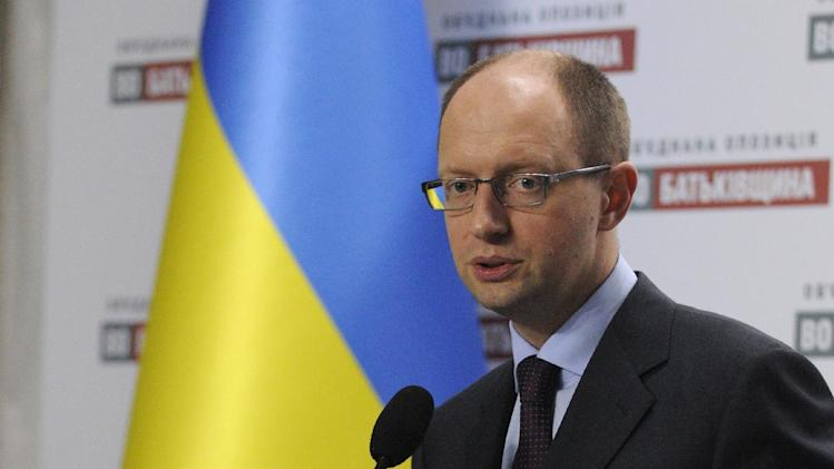 """Ukrainian opposition leader Arseniy Yatsenyuk speaks during a news conference in Kiev, Ukraine, Tuesday, Oct. 30, 2012.  Ukraine's parliamentary election was marked by an uneven playing field and biased media coverage that reversed many of the democratic gains the country had made in recent years, international observers said on Monday, and opposition leader Yatsenyuk said, """"People are going onto the streets because they feel like it and politicians can not dictate to them. When people see that the results of the elections have been stolen like it was in 2004, they head to the streets to defend their votes.  (AP Photo/Sergei Chuzavkov)"""