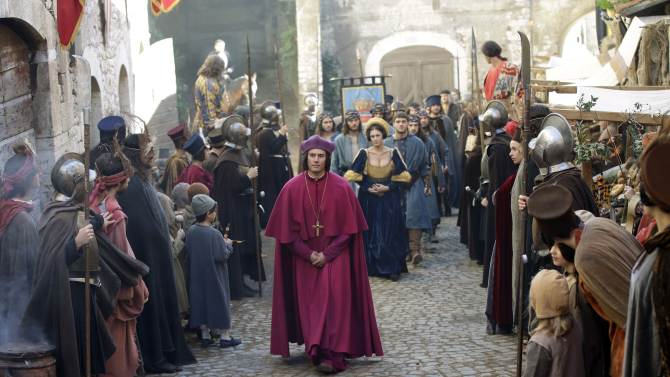 """In this photo taken Monday, Oct. 29, 2012, actors perform during the shooting of """"Borgia"""" tv series in Sermoneta, Italy.   The Italian economy may be struggling but the pan-European television series """"Borgia,"""" which is now filming its second season in Italy, is a thriving hit on the world market. Spanning the late Middle Ages to the early Renaissance period, the show follows the famous Borgia family's rise to power and subsequent domination of the Vatican and southern Europe's political landscape. A winning combination of sex, violence, faith, lust and betrayal, the primarily French-German production has been sold in 85 countries worldwide. (AP Photo/Gregorio Borgia)"""