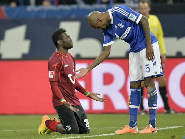 Hannover's Mame Diouf of Senegal, left, refuses to shake hands with Schalke's Felipe Santana of Brazil, right, during the German Bundesliga soccer match between FC Schalke 04 and SV Hannover 9