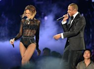 Beyonce Knowles and Jay-Z perform on stage during the 56th Grammy Awards at the Staples Center in Los Angeles, California, January 26, 2014