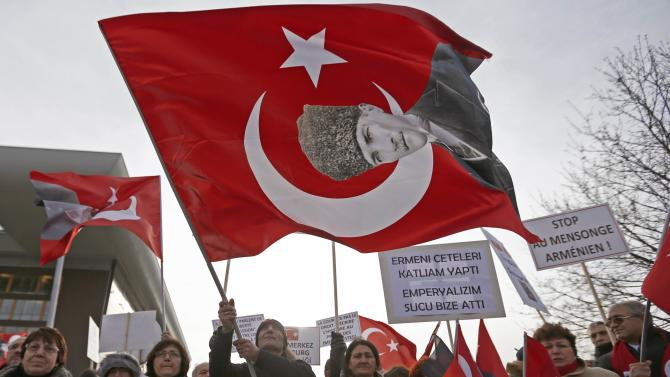 A Turkish protester waves a flag with a portrait of Mustafa Kemal Ataturk as he takes part in a demonstration near the European Court of Human Rights in Strasbourg
