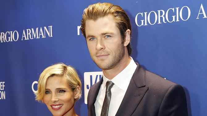 """FILE - In this Jan. 11, 2014 file photo, Elsa Pataky, left, and Chris Hemsworth arrive at the 3rd Annual Sean Penn & Friends HELP HAITI HOME Gala at the Montage Hotel in Beverly Hills, Calif. Hemsworth and his wife Pataky have welcomed not one, but two sons. The twins of the 30-year-old """"Thor: The Dark World"""" star and the 37-year-old """"Fast and Furious 6"""" actress were born in Los Angeles, confirmed on Friday, March 21, 2014 by Hemsworth's publicist, Robin Baum. (Photo by Colin Young-Wolff /Invision/AP, file)"""