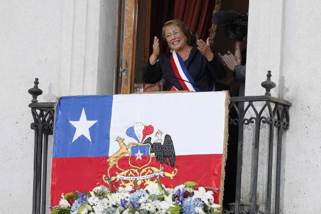 Chile's new president Michelle Bachelet gestures as she arrives at the La Moneda presidential palace after being sworn into office, in Santiago