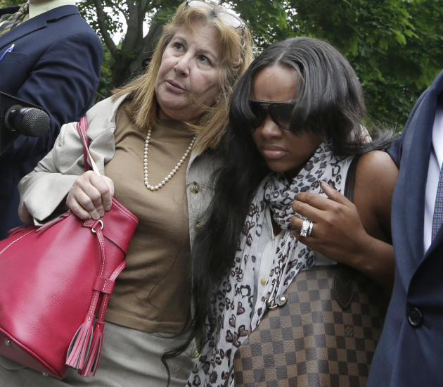 Shayanna Jenkins, right, fiancee of former New England Patriots football player Aaron Hernandez, is escorted by attorney Janice Bassil after a bail hearing in Fall River Superior Court Thursday, June