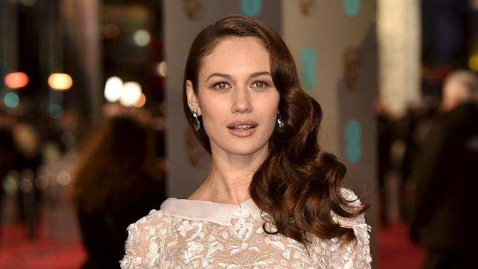 Olga Kurylenko arrives at the British Academy of Film and Television Arts (BAFTA) Awards at the Royal Opera House in London