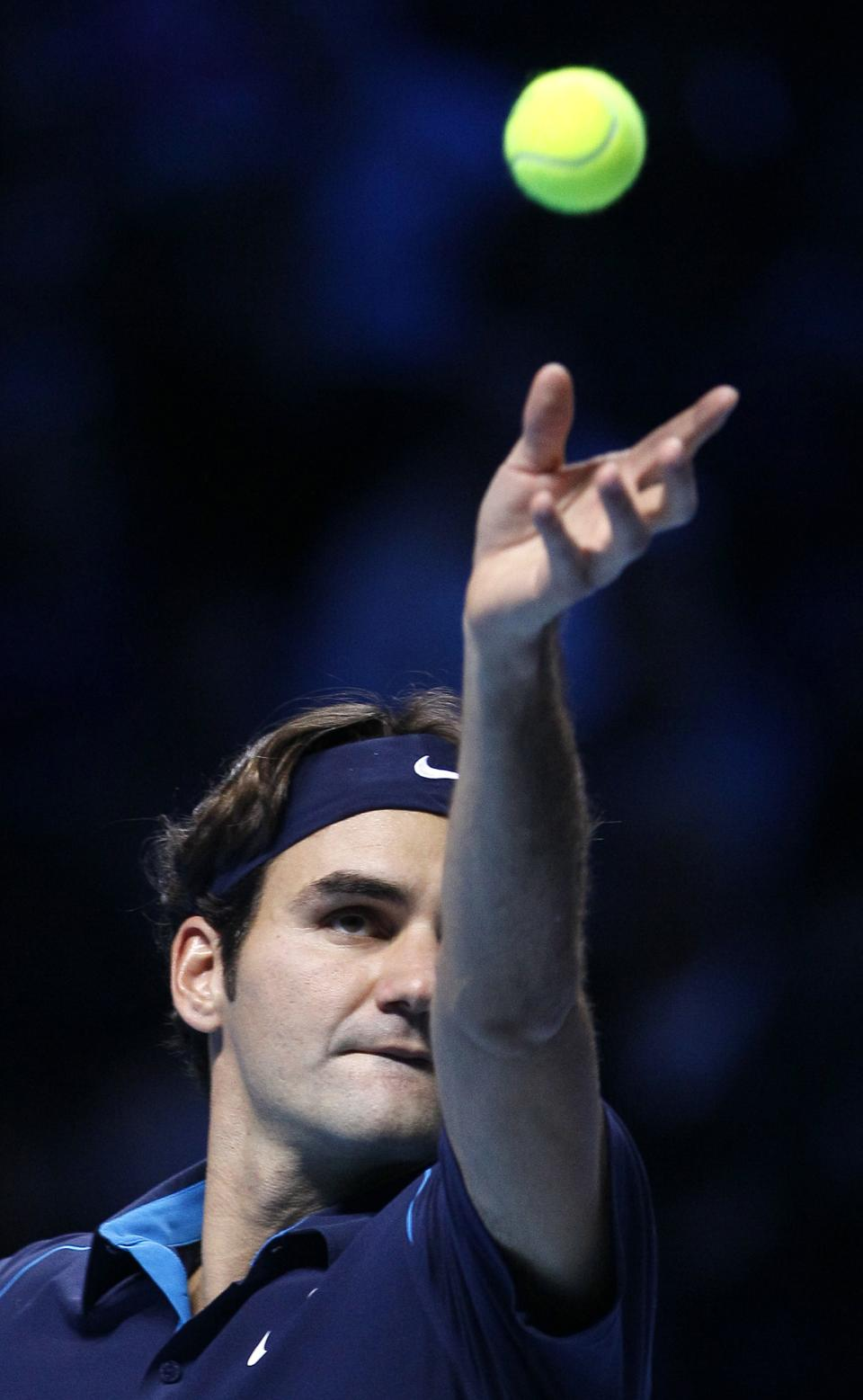 Roger Federer of Switzerland serves to Rafael Nadal of Spain during their round robin singles match at the ATP World Tour Finals, at the O2 arena in London, Tuesday, Nov. 22, 2011. (AP Photo/Kirsty Wigglesworth)