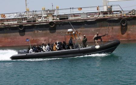 Libyan Navy boat carries illegal migrants who attempted to flee the coast to Europe back to the coastal city of Tripoli