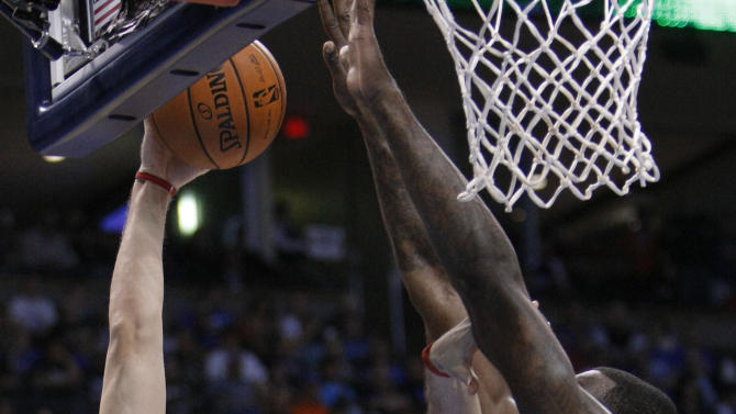 Toronto Raptors center Andrea Bargnani (7) goes up for a basket in front of Oklahoma City Thunder center Kendrick Perkins (5) during the first quarter of an NBA basketball game in Oklahoma City, Tuesday, Nov. 6, 2012. (AP Photo/Alonzo Adams)
