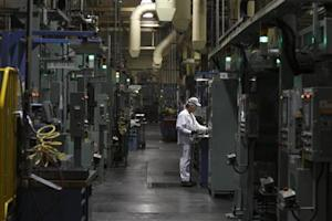 An associate is seen working in the connecting rod area during a tour of the Honda automotive engine plant in Anna