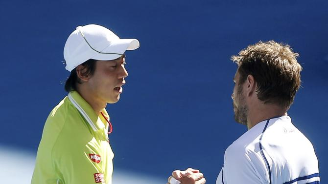 Kei Nishikori (L) of Japan shakes hands with Stan Wawrinka of Switzerland after being defeated in their men's singles quarter-final match at the Australian Open 2015 tennis tournament in Melbourne