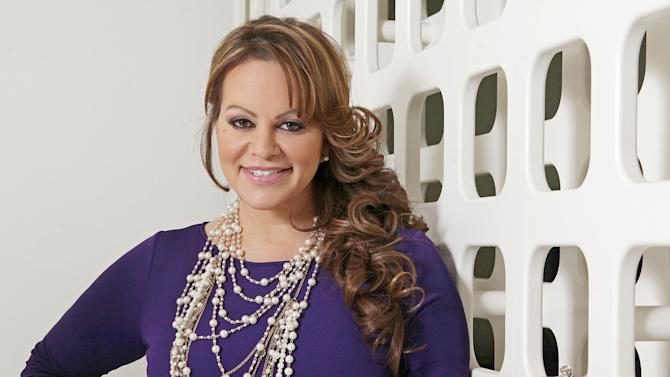 FILE - In this March 8, 2012, file photo, Mexican-American singer and reality TV star Jenni Rivera poses during an interview in Los Angeles. Mexican authorities confirmed that the plane in which Rivera was traveling disappeared early Sunday, Dec. 9, 2012, after leaving the Mexican northern city of Monterrey where she performed in concert on Saturday night. (AP Photo/Reed Saxon, file)