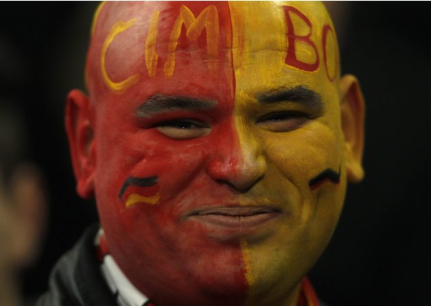 A supporter of Galatasaray poses before the Champions League soccer match against Schalke 04 in Gelsenkirchen