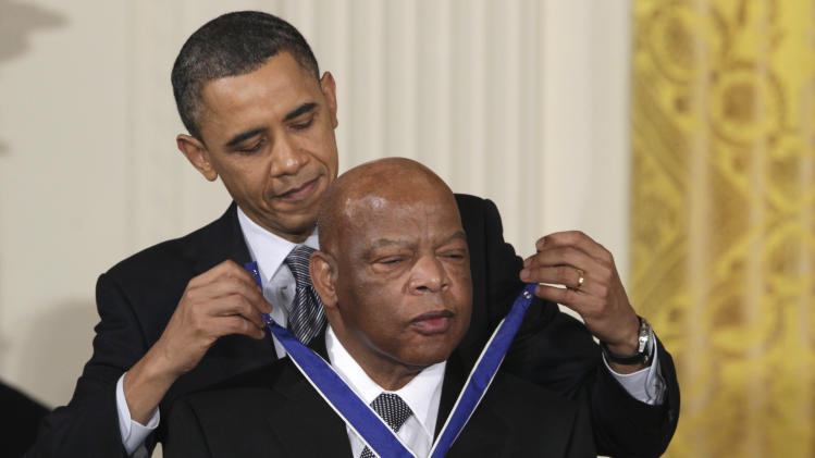 President Barack Obama presents a 2010 Presidential Medal of Freedom to Rep. John Lewis, D-Ga., Tuesday, Feb. 15, 2011, during a ceremony in the East Room of the White House in Washington. (AP Photo/Carolyn Kaster)