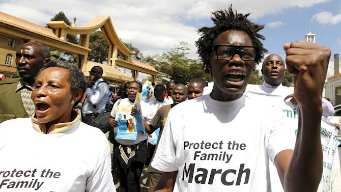 Members of the anti-gay caucus chant slogans against the LGBT community as they march along the streets in Kenya's capital Nairobi