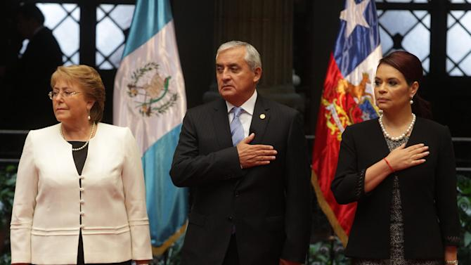 Chile's President Bachelet, Guatemala's President Perez, and Guatemalan Vice President Baldetti attend a welcoming ceremony in the presidential palace in Guatemala City