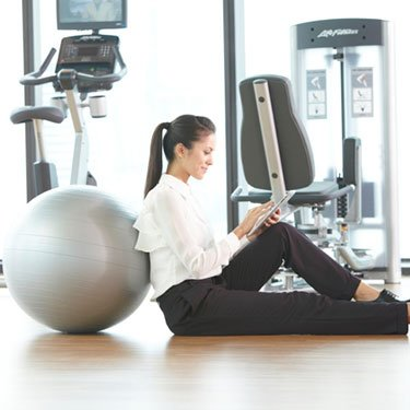 Businesswoman-leaning-against-yoga-ball_web