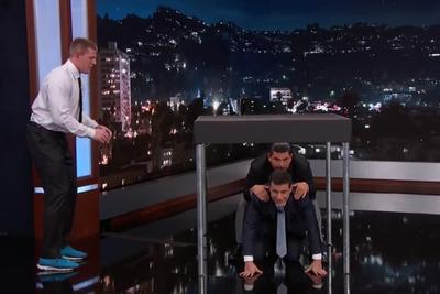 J.J. Watt jumps over Jimmy Kimmel, all while wearing a suit