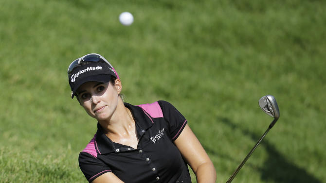 Beatriz Rescari, of Spain, hits out of the rough on the first hole during the first round of the U.S. Women's Open golf tournament, Thursday, July 5, 2012, in Kohler, Wis. (AP Photo/Julie Jacobson)