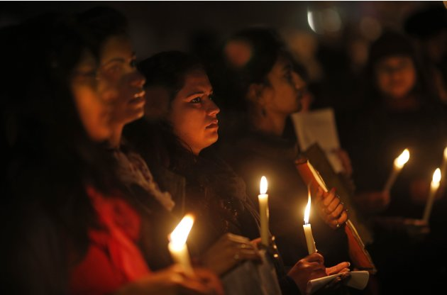 Indians hold a candle light vigil to salute the undying spirit of a rape victim and to mourn her death in New Delhi, India , Sunday, Dec. 30, 2012. The young woman who died after being gang-raped and