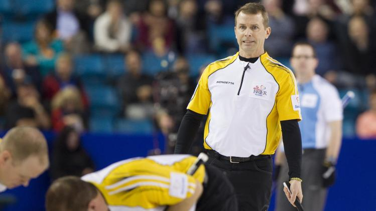 Team Manitoba skip Jeff Stoughton watches a replay after missing a shot in seventh end against team Quebec during their draw at the 2014 Tim Hortons Brier curling championships in Kamloops.