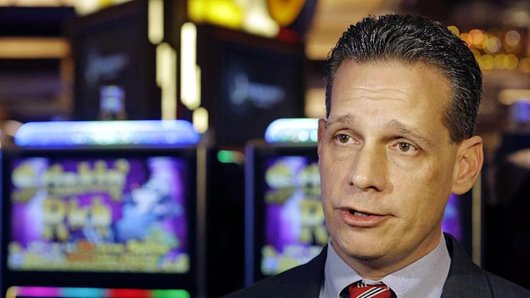 Matt Schuler, executive director of the Ohio Casino Control Commission, speaks to the media inside Horseshoe Casino Cincinnati, Tuesday, Feb. 26, 2013, in Cincinnati. The casino with a 100,000 foot gaming floor is set to open to the public Monday, March 4. (AP Photo/Al Behrman)