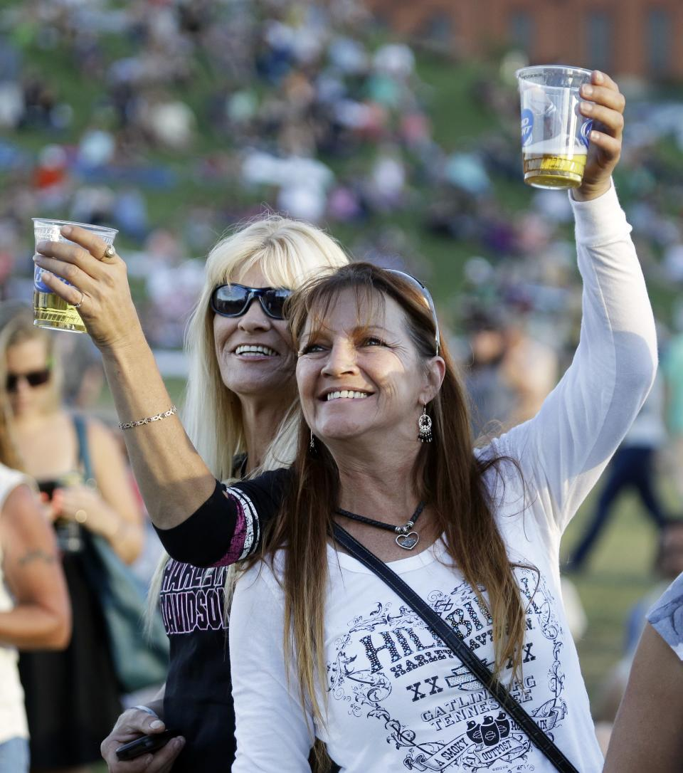 In this Sept, 28, 2013 photo, people attend a Willie Nelson concert at the Southern Ground Music & Food Festival in Nashville, Tenn. Events like the festival provide a link between the city's established music scene and its growing food influence. (AP Photo/Mark Humphrey)