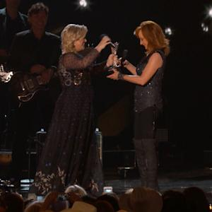 Kelly Clarkson Tells ACMs Audience to 'Suck It' While Bragging on In-Law Reba McEntire