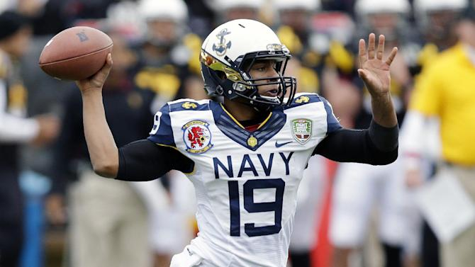 Navy quarterback Keenan Reynolds throws against Arizona State during the first half of the Fight Hunger Bowl NCAA college football game in San Francisco, Saturday, Dec. 29, 2012. (AP Photo/Marcio Jose Sanchez)