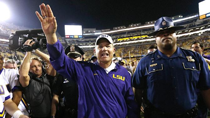 LSU head coach Les Miles celebrates after an NCAA college football game against Texas A&M in Baton Rouge, La., Saturday, Nov. 28, 2015. LSU won 19-7. (AP Photo/Jonathan Bachman)