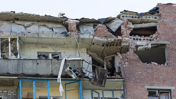 A damaged house is seen after shelling in the city of Kramatorsk, Donetsk region, eastern Ukraine, Thursday, July 3, 2014. Residential areas came under shelling on Thursday from government forces. (AP Photo/Dmitry Lovetsky)