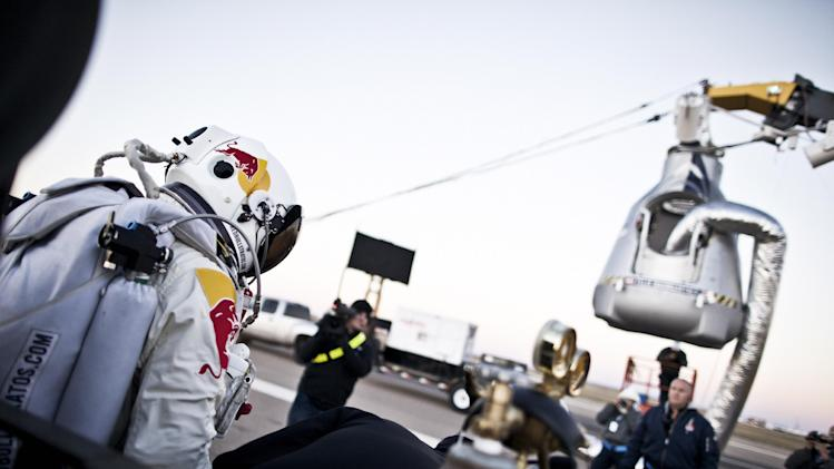 In this photo provided by Red Bull, Pilot Felix Baumgartner of Austria steps out from his trailer during the final manned flight for Red Bull Stratos in Roswell, N.M. on Saturday, Oct. 14, 2012.  Baumgartner plans to jump from an altitude of 120,000 feet, an altitude chosen to enable him to achieve Mach 1 in free fall, which would deliver scientific data to the aerospace community about human survival from high altitudes.(AP Photo/Red Bull Stratos, Balazs Gardi) MANDATORY CREDIT