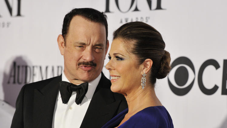 Best performance by an actor in a leading role in a play nominee Tom Hanks, left, and actress Rita Wilson arrive on the red carpet at the 67th Annual Tony Awards, on Sunday, June 9, 2013 in New York. (Photo by Charles Sykes/Invision/AP)