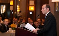 Australian opposition leader Tony Abbott delivers a speech at a breakfast meeting hosted by the China-Australia Chamber of Commerce in Beijing on July 24, 2012. Abbott described Chinese business ownership this week as a &quot;complicated&quot; issue due to the prevalence of state-owned corporations in the world&#39;s second-largest economy