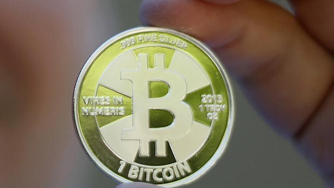 Some of Bitcoin enthusiast Mike Caldwell's coins in this photo illustration at his office in Sandy, Utah