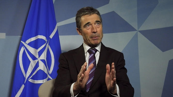 NATO Secretary General Anders Fogh Rasmussen speaks with the Associated Press at NATO headquarters in Brussels on Monday, April 30, 2012. NATO's top official is vigorously defending the alliance's plan for a shield against ballistic missiles, despite two U.S. reports which cast doubt on project's technical and financial feasibility. (AP Photo/Virginia Mayo)